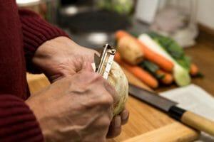 eldery person preparing food
